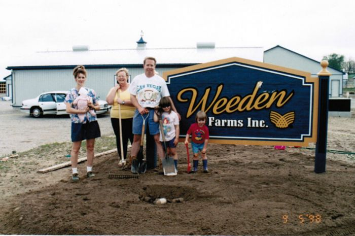 Kevin Weeden with his mother, wife and daughters in front of Weeden Farms, a state of the art Male Turkey Breeder facility built by Kevin in 1998